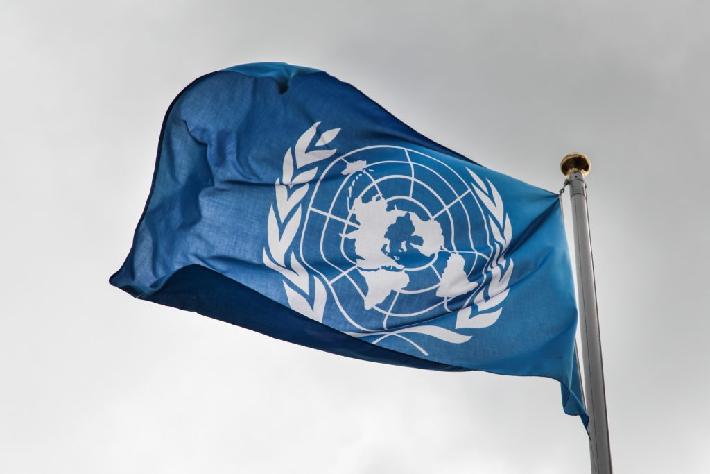 UN flag against grey sky