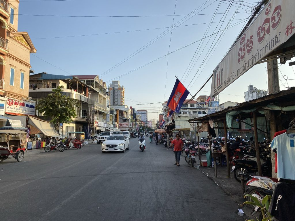 Street in Cambodia with waving flags